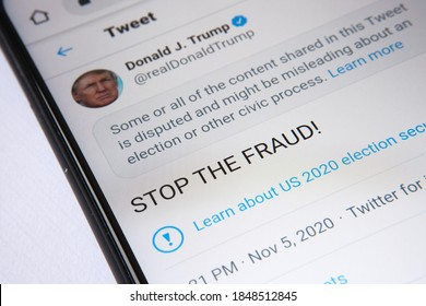 """Twitter labelled official Donald Trump's """"STOP THE FRAUD"""" tweet as """"disputed"""". The Page is seen on the smartphone screen. Concept. Stafford, United Kingdom - November 6 2020."""