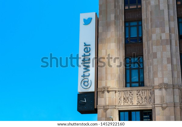 Twitter sign and logo on facade of global headquarters building at 1355 Market Street - San Francisco, California, USA - July 12, 2019