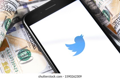 Twitter symbol on the white display smartphone and money. Twitter is a social media online service for microblogging and networking communication. Moscow, Russia - March 1, 2019