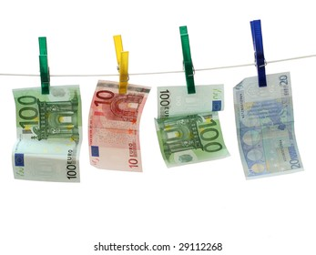Two 100 Euro bills and one 20 and 10 Euro note on white rope. Concept of Money Laundry