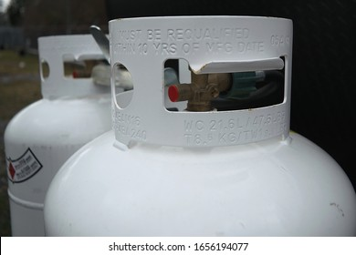 Two 20 pound propane tanks secured to the front of an RV travel Trailer