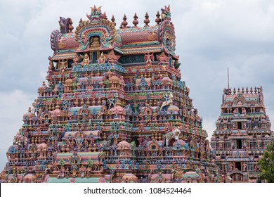 Two of the 21 entrance gateways, or Gopuram, at the Ranganathaswamy temple at Trichy in Tamil Nadu, India. The state is renowned for its temples and for the local fashion for painting the gateways