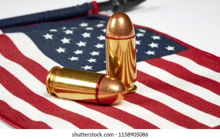 Two .45 caliber bullets on an American Flag
