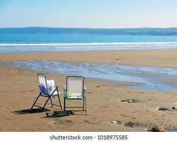 Two abandoned chairs on deserted beach