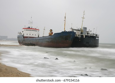 Two abandoned ships on the seashore after shipwreck