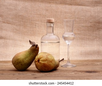 Two Abate Fetel pear with alcohol bottle and glass, horizontal