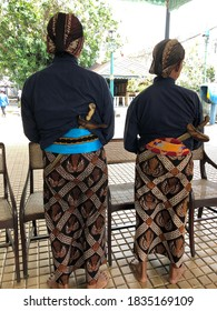 Two Abdi dalem (royal servant) of Yogyakarta Palace with their uniform and accessorries are welcoming the guests