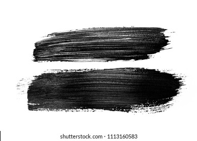 Two abstract grunge brush stroke made with slack acrylic paint, isolated on white. Perfect for your design.
