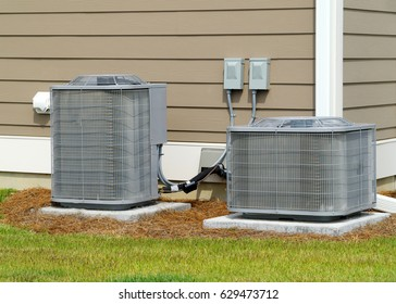 Two A/C units connected to residential house