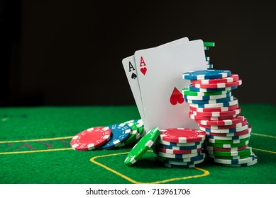 two ace in poker game. cards and chips on casino background