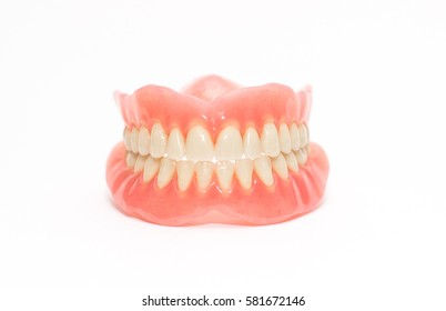 Two acrylic dentures ,white background.