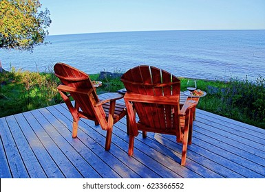 Two adirondack chairs on deck by the lakeside