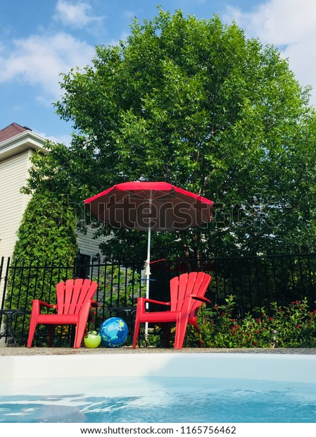 Cool Two Adirondack Red Chair By Swimming Stock Photo Edit Now Andrewgaddart Wooden Chair Designs For Living Room Andrewgaddartcom