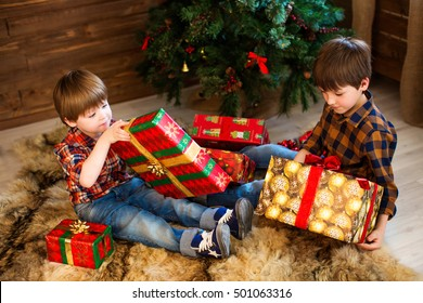 Two adorable boys, opening presents on Christmas.