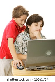 Two adorable brothers using the computer together.  Isolated on white.