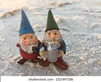 Two adorable cheerful elderly men brothers garden gnomes on beach vacation standing together in clean pristine sand enjoying the sunset