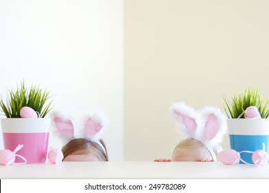 Two adorable little sisters wearing bunny ears on Easter day
