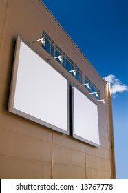 Two ads with copy-space on abstract building wall over blue sky