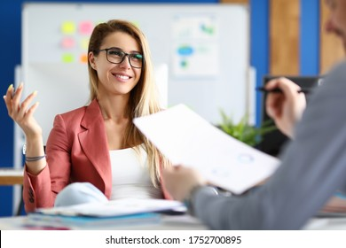 Two adult business people make work interview against office background.One on one meeting concept.