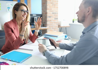 Two adult business people make work interview against office background.One on one meeting concept. - Shutterstock ID 1752700898
