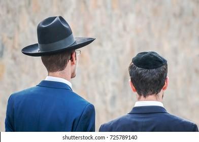 Two adult Hasidim in traditional Jewish headdresses hat and kippah. Prayer of Hasidim.