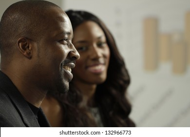 Two African American business man and woman in a meeting