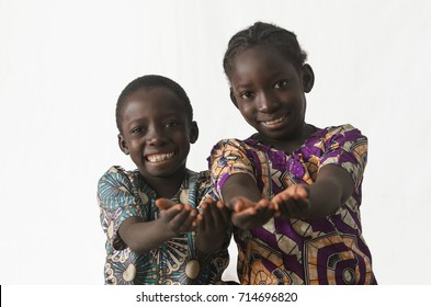 Two African children showing their palms asking begging for some