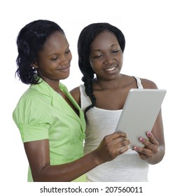 Two african women discussing with tablet PC, Studio Shot