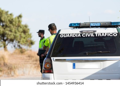 Two agents of the civil traffic police with their patrol car in Madrid. (Traffic civil guard)