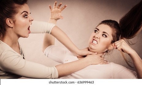 Two agressive women having argue fight being mad at each other. Female violance concept.