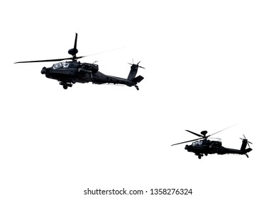 Two AH-64 Apache attack helicopter flying a demo on white background.2019/3/30 in Taiwan
