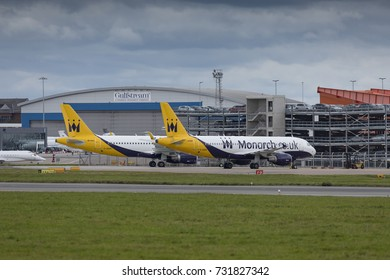 Two Airbus A320 aircraft, G-ZBAS and G-OZBX, of Monarch Airlines parked up on October 7th 2017 at London Luton Airport, Bedfordshire, UK