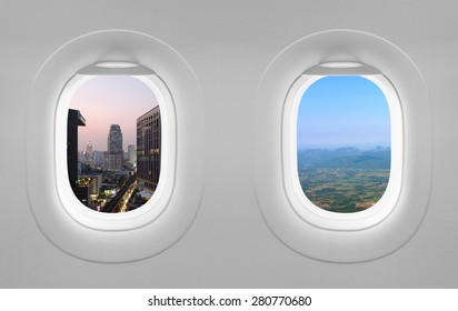 Two airplane windows with sunset city and mountain view,  twilight Bangkok landscape outside window plane