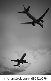 Two airplanes, silhouettes - decorative photomontage