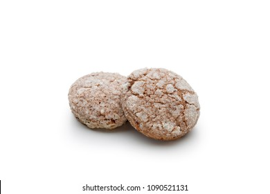 Two almond bisquits called Amaretti on white background