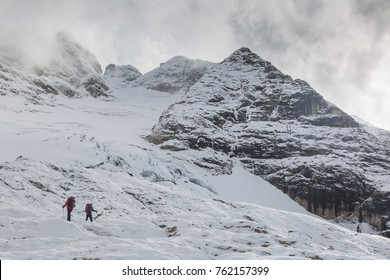 Two alpinists crossing the glacier in Itallian alps