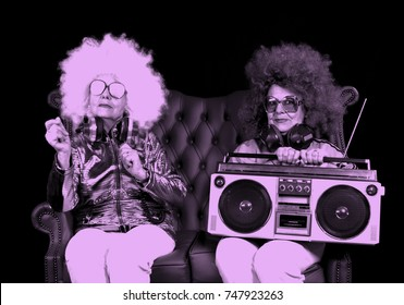 two amazing grandmas partying in a disco setting holding a retro ghettoblaster