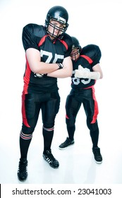 Two American football players over white background
