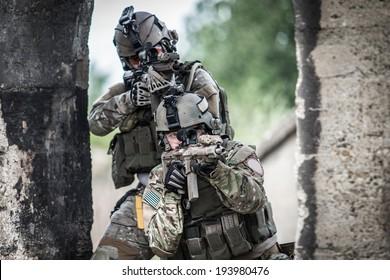 two american soldiers shooting through door