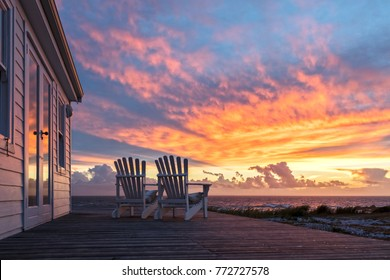 Two Ampty Chairs Facing Magficent Sunset View at Beach
