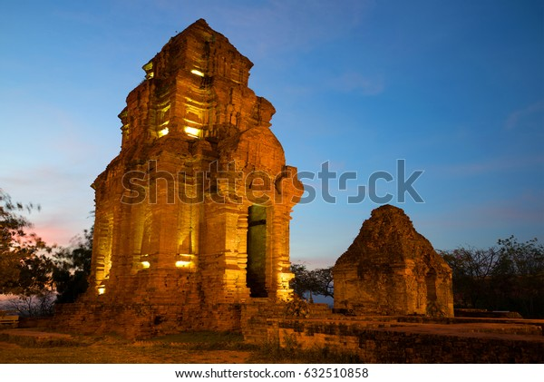 Two ancient Hindu temples (Cham Tower) in the evening twilight. Phan Thiet, Vietnam