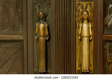 Two angels, side by side, serve as door handles on the door of Notre Dame in Luxembourg.  With use, one now looks golden, the other tarnished.