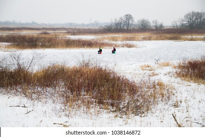 two anglers on a frozen river