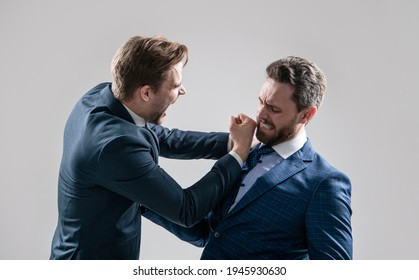 two angry businessmen punching in fight and arguing having struggle for leadership on businessmeeting because of business competition, confrontation.