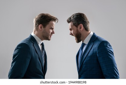 two angry businessmen shouting face to face arguing having struggle for leadership on businessmeeting have business competition, contradiction.