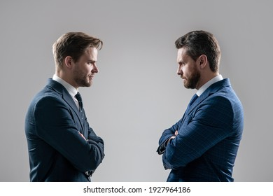 two angry businessmen standing face to face having struggle for leadership on businessmeeting because of business competition, business competition.