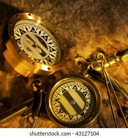 Two antique brass compasses shot on textured background