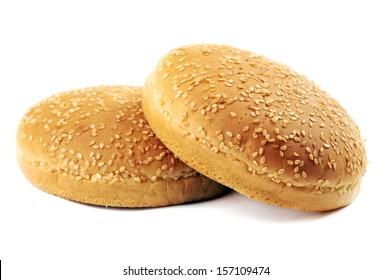 Two appetizing fresh burger buns on white background