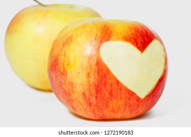 Two apples and heart shape on one apple