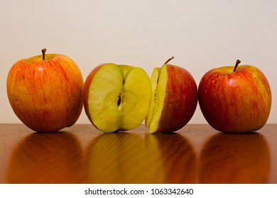 two apples and one cut apple